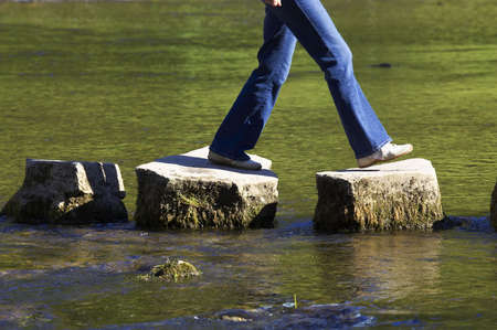 across: crossing three stepping stones in a river