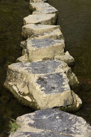 across: Stepping stones across river Stock Photo
