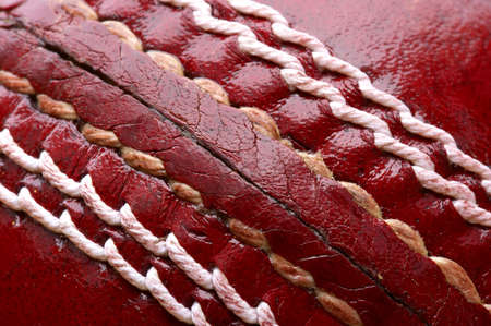 Close up shot of a red cricket ball Stock Photo