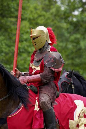 showmanship: red knight on horseback, warwick castle, England