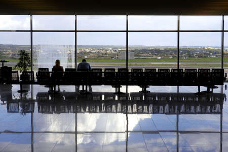 airport lounge: Two passengers waiting in airport lounge, palma airport, mallorca, majorca, spain Stock Photo