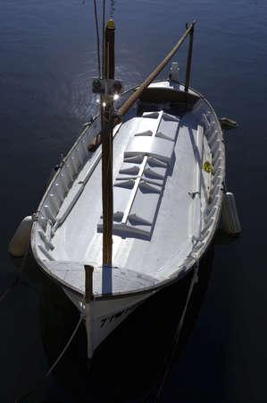 spainish: Single wooden white fishing boat, port cala bona, mallorca, majorca, spain