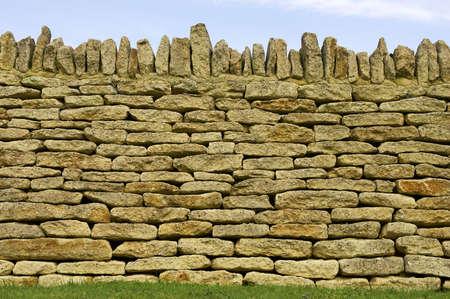 stoneworks: Dry stone wall detail, Batsford church, Gloucestershire, England, uk Stock Photo