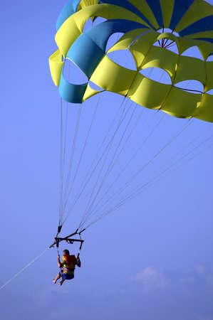 Male parasailing against blue sky, Key Largo, Florida, USA