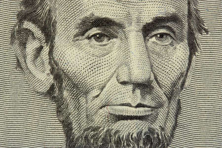 president Lincoln face on the five dollar bill photo