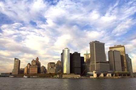view of downtown manhattan at dusk from the Staten island ferry, Statten island ferry terminal is at the bottom right, new york, America, usa Stock Photo