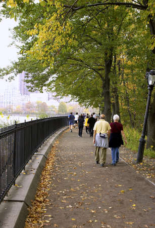 Joggers and walkers around the reservoir, central park, Manhattan, New York, America, USA Stock Photo