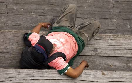 slumped: Down and out, south street seaport, lower manhattan, new york, America, usa