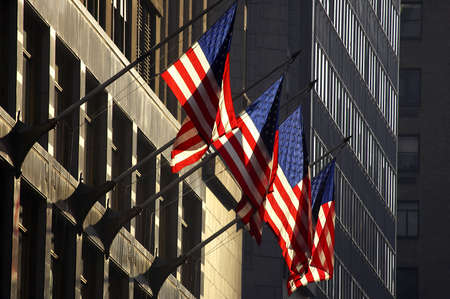 Four american flags against a building, manhattan, new york, america, usa photo
