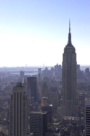 View of empire state building and downtown manhattan from the roof of the rockefeller building, new york, america, usa