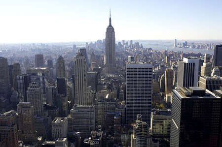 distant work: View of empire state building and downtown manhattan from the roof of the rockefeller building, new york, america, usa Stock Photo