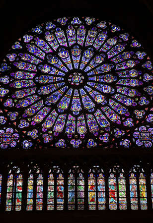 North transcept rose stained glass window in Notre dame cathedral, Paris, France
