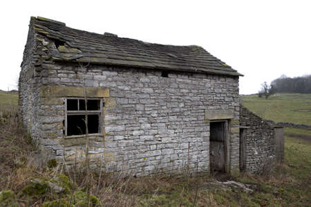 dilapidation: Deserted farmhouse, Youlgreave, Peak District National Park, Derbyshire, England, UK, taken in January 2006 Stock Photo