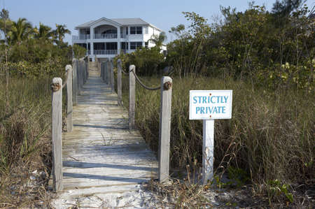 fairly: Private entrance to a beach front property on Sanibel beach, focus point is on the sign leaving the house slightly out of focus as aperture was fairly shallow, Sanibel Florida USA taken in March 2006