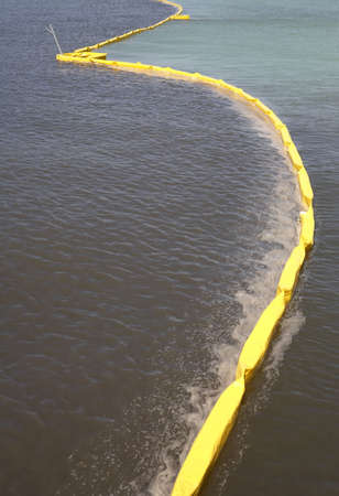 water damage: Pollution control barrier in the sea viewed from the city pier Anna maria island florida united states usa taken in march 2006 Stock Photo