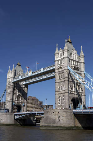 recognised: london tower bridge on the river thames one of Londons most famous landmarks opened in 1894 and is easily recognised by its twin gothic towers london england uk europe taken in june 2006 from the south bank queens walk