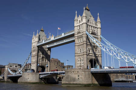 london tower bridge on the river thames one of London's most famous landmarks opened in 1894 and is easily recognised by its twin gothic towers london england uk europe taken in june 2006 from the south bank queens walk Stock Photo - 445425