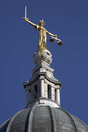 left hand: statue of justice, a woman holding a sword in her right hand standing for the power to punish and a balance in her left hand standing for equity on the roof of the old bailey, officially known as the central criminal court london england uk europe taken i