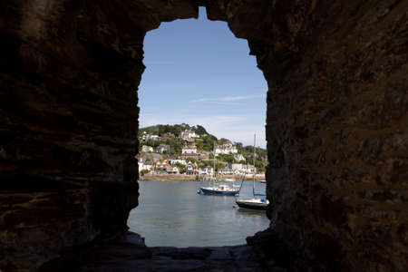 view through the window of bayards cove fort towards the mouth of the river dart, start bay with the castle on the right dartmouth devon england europe uk taken in july 2006 photo