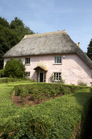 traditional pink painted english cottage in the small village of cockington torquay torbay devon england europe uk taken in july 2006 Stock Photo - 476828