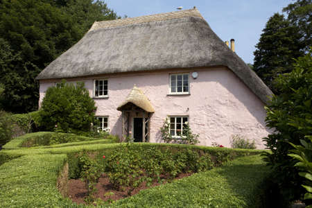 traditional pink painted english cottage in the small village of cockington torquay torbay devon england europe uk taken in july 2006 Stock Photo - 476827