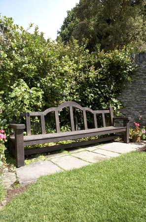 view of a garden bench in devon england europe uk taken in july 2006 photo