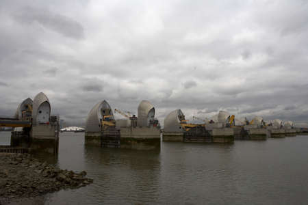 moveable: thames barrier the millennium dome can be seen in the gap between two of the gates woolwich docklands london city england taken in september 2006