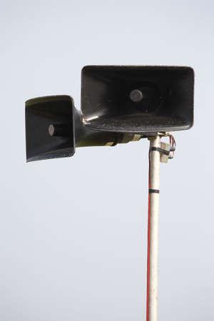 pa: public pa address system speakers on a metal pole