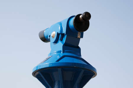 operated: blue coin operated telescope Stock Photo