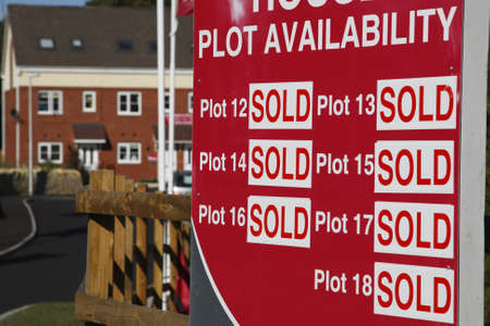 plots all sold sign with the house development in the background colliery lane bedworth warwickshire england uk