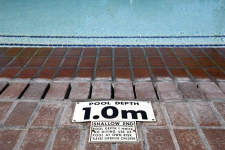 pool depth sign at the edge of the swimming pool knysna western cape province south africa photo