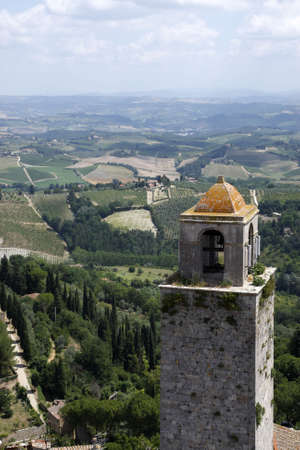 top of the bell tower with the rolling tuscany countryside beyond from the torre grossa san gimignano tuscany italy europe