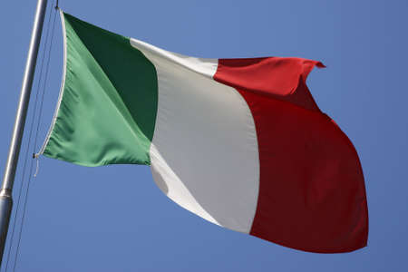 the italian flag flying in the breeze forte dei marmi versilia lucca northern tuscany coast italy europe Stock Photo