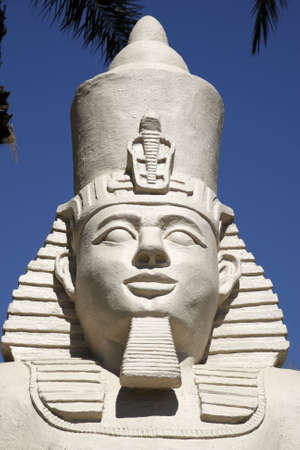 replica statue of ramses II against a blue sky