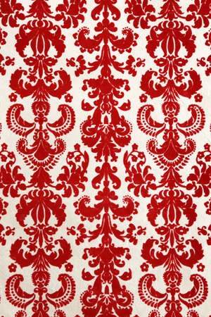detail of red flock wallpaper pattern Stock Photo
