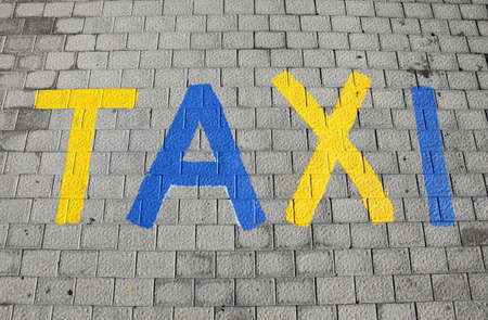 taxi parking sign on a cobbled street maspalomas gran canaria