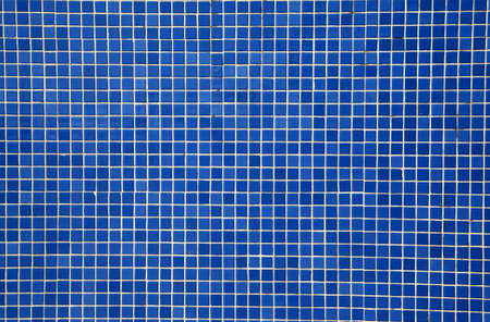 tile grout: blue mosaic tiles on a wall