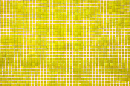 yellow mosaic tiles on a wall Stock Photo