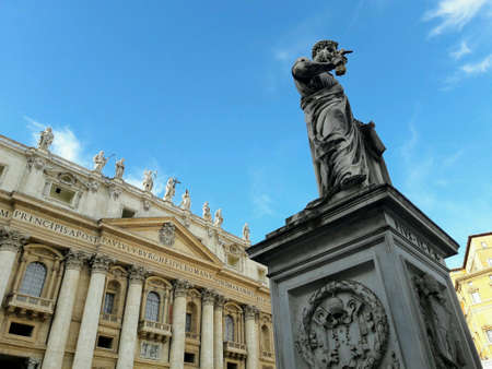pius: St. Peters Basilica and statue of Pope Pius IX in St. Peters Square; Vatican City, Italy Stock Photo