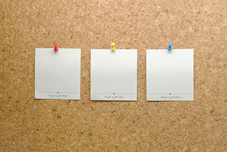 tack board: Paper cards posted on a cork board with tack pin Stock Photo