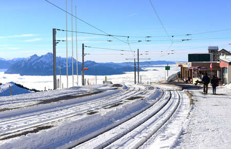 tramway: railway or tramway track in winter with the sea of clouds background, Rigi Kulm, Switzerland