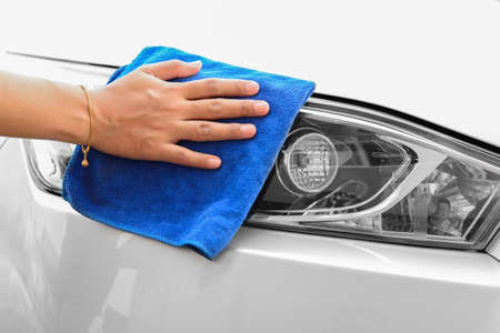 microfiber cloth: Hand with microfiber cloth cleaning car