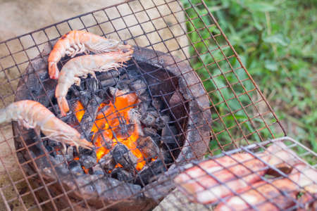 burning firewood in stove for grill, Thai traditional cooking