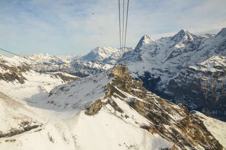 Cable Car station with View of Swiss Alps in winter, Switzerland.