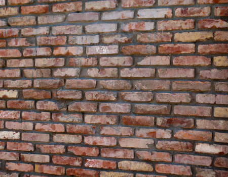 Wall made of bricks and cement Stock Photo