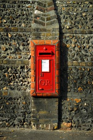 flint: Old Postbox with King George V (1910�1936) marks on it, set in a flint wall with red bricks surrounding it.