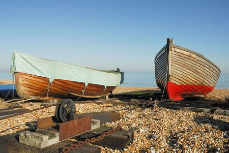 Two large sea going rowing boats on a pebbled beach photo