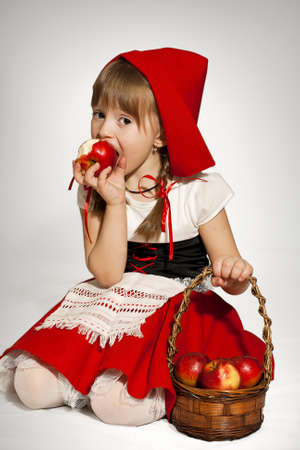 amiable: A girl wearing Little Red Riding Hood costume Stock Photo