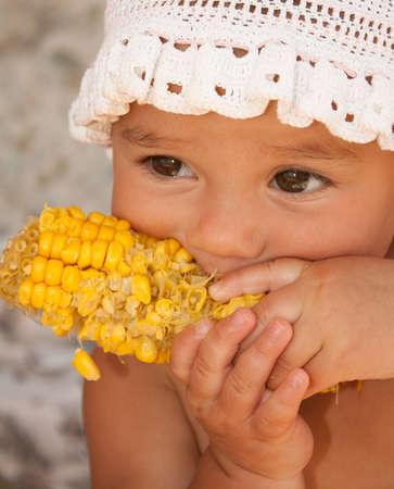 nibble: A little child biting maize