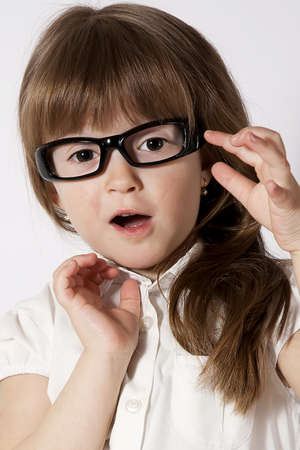 A portrait of the amazed girl wearing glasses